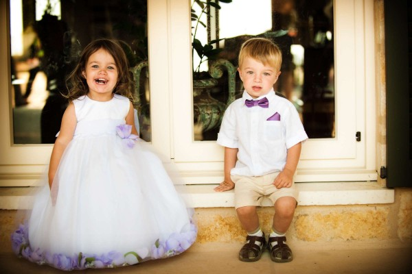 San Diego Wedding Photography: True Photography captures cute flower girl and ring bearer in white and purple outfits