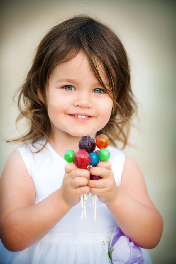 San Diego Wedding Photography: True Photography captures flower girl with colorful lollipops