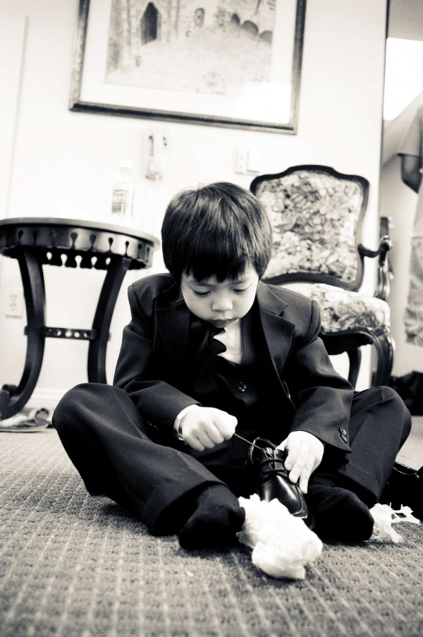 San Diego Wedding Photography: True Photography captures ring bearer getting ready for the wedding