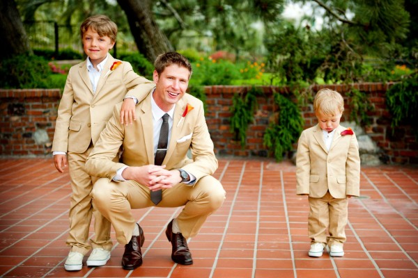San Diego Wedding Photography: True Photography captures funny photo of a little ring bearer in a tan suit before the wedding