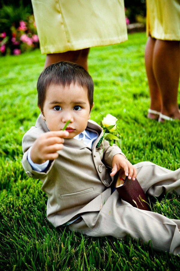 San Diego Wedding Photography: True Photography captures ring bearer sitting during wedding reception