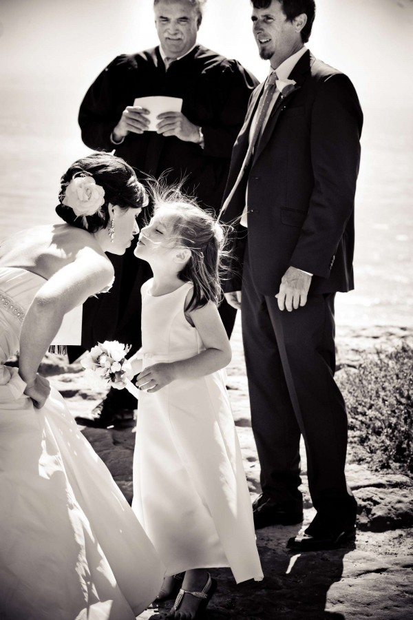 San Diego Wedding Photography: True Photography captures mom giving daughter a kiss duirng wedding ceremony