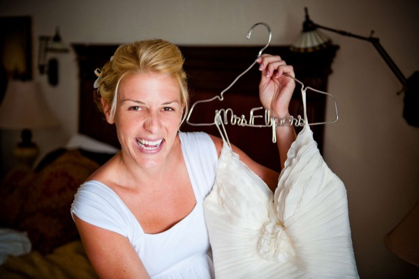 San Diego Wedding Photography: True Photography captures bride with personalized hanger and groom getting ready for the ceremony