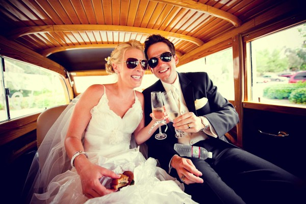 San Diego Wedding Photography: True Photography photographs bride and groom wearing sunglasses and toasting in car after ceremony