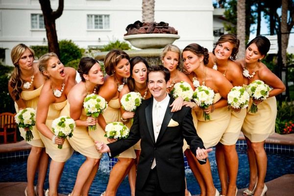 San Diego wedding photographer True Photography photographs bridesmaids with groom after wedding ceremony