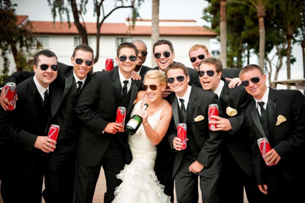 San Diego Wedding Photography: True Photography captures fun photo of groomsmen with the bride wearing sunglasses after wedding ceremony in San Diego