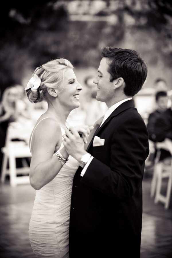 San Diego Wedding Photography: True Photography captures bride and groom first dance smiling in black and white