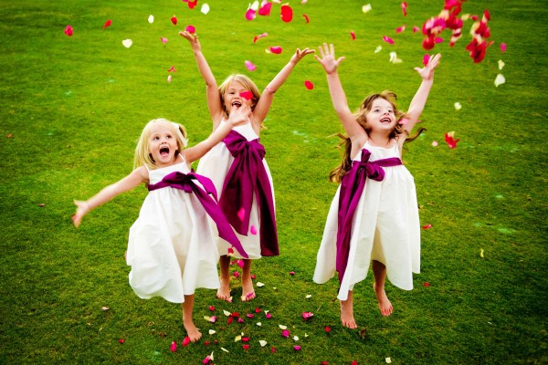 San Diego Wedding Photography: True Photography captures flower girls thorwing flowers at San Diego wedding