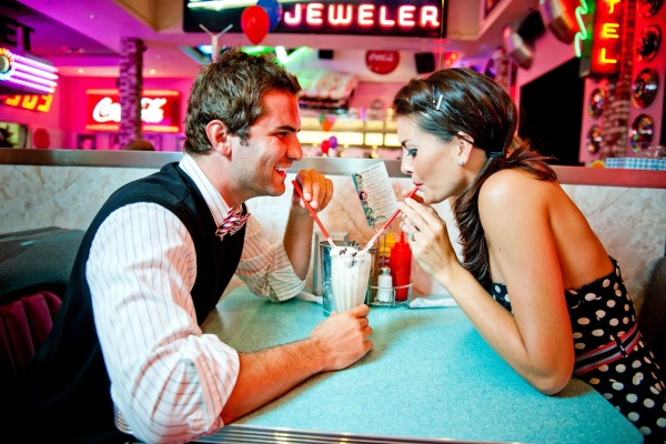 San Diego wedding photography: True Photography captures couple sharing ice cream at a diner during a retro engagement shoot