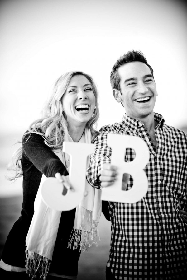 San Diego Wedding Photographer: True Photography captures laughing couple holding letter blocks during engagement shoot in San Diego