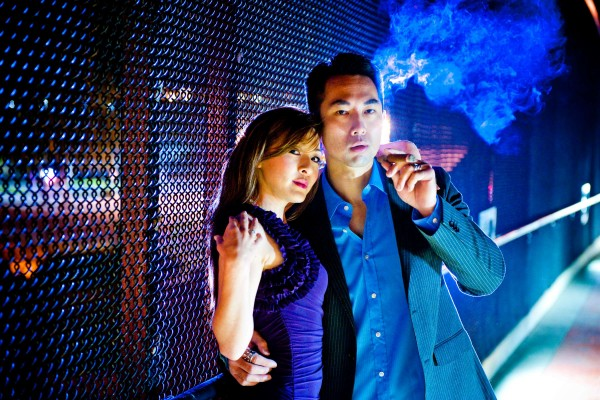 San Diego Wedding Photographer: True Photography during a night shot on a bridge smoking a cigar for a cool effect