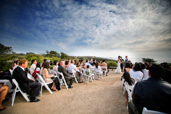San Diego wedding photographer True Photography captures bride getting ready and the beautiful wedding ceremony site at Torrey Pines State Reserve overlooking the ocean