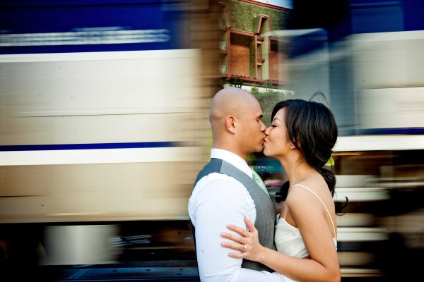 San Diego wedding photographer True Photography: unique and fun wedding photo of bride and groom in front of moving train