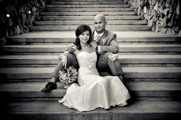 San Diego wedding photographer True Photography bride and groom pose on stairs at southern California wedding