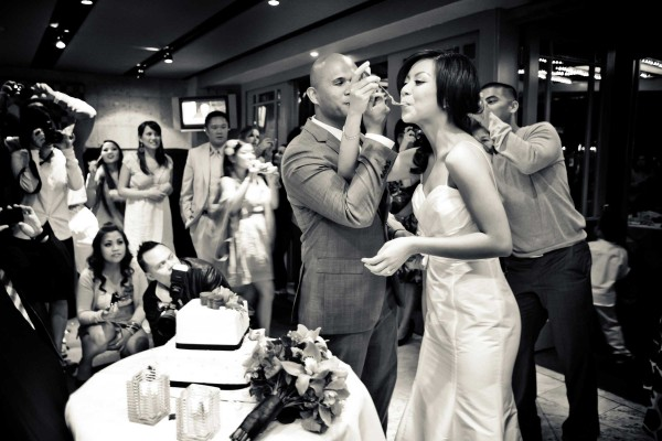 San Diego wedding photographer True Photography captures cake cutting with bride and groom
