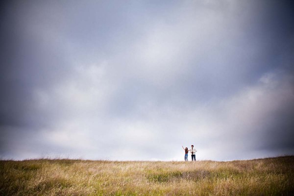 San Diego Wedding Photography: True Photography captures couple in a field during engagement shoot in San Diego