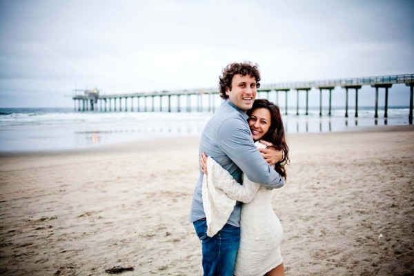San Diego Wedding Photography: True Photography captures couple on the beach by the pier in engagement shoot