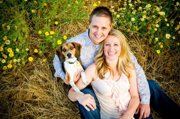 San Diego Wedding Photographers engagement shoot couple in a field with a dog
