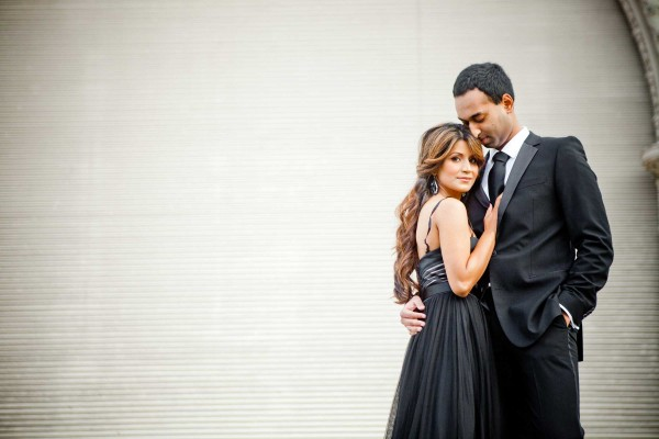 Engagement shoot in tuxedo and black gown at the Organ Pavilion at Balboa Park in San Diego