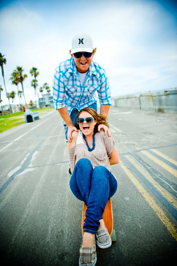 San Diego Wedding photography engagement shoot skateboarding on the boardwalk in Pacific Bach San Diego