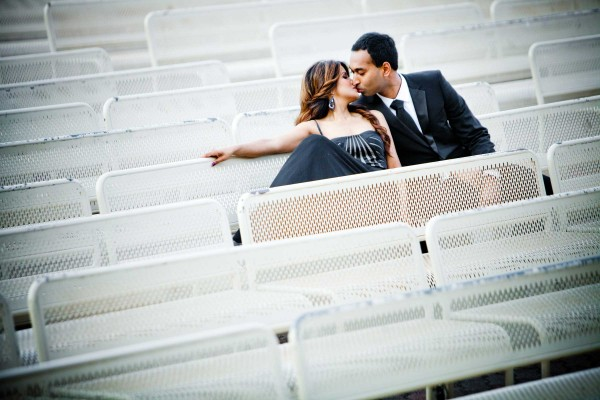Wedding photography in San Diego in the seats at Balboa Park Organ Pavillion