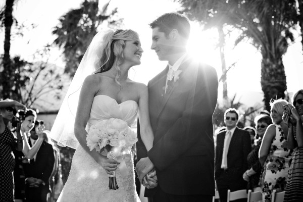 San Diego Wedding Photography bride and groom during ceremony with sun shining in Palm Springs