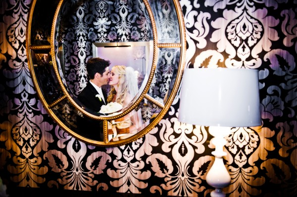 San Diego Wedding Photography: Modern Rivierta Resort in Palm Springs reflection in the mirror of bride and groom
