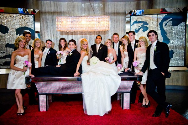 San Diego Wedding Photography captures bridal party on pool table at Riviera Hotel in Palm Springs