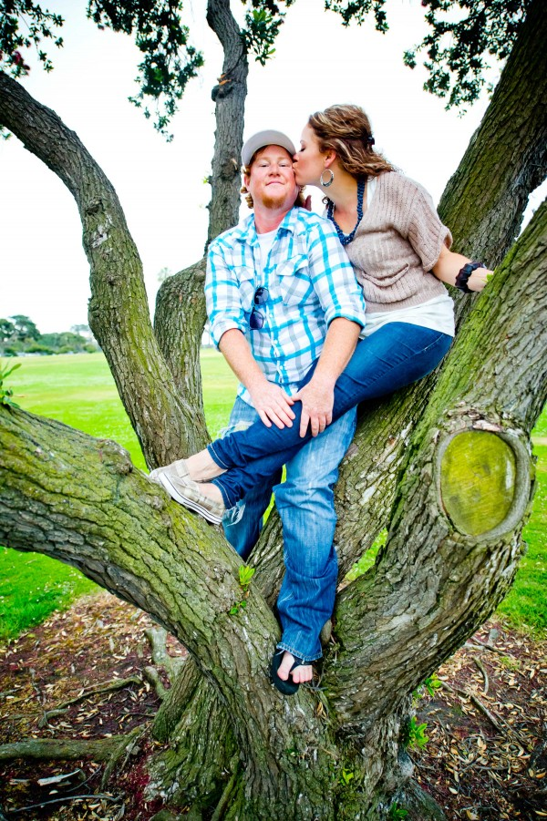 San Diego wedding photographer engagement shoot kissing in a tree