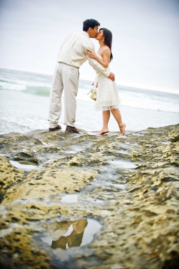 True Photography San Diego Wedding Photography enagement photo shoot at the beach in white kissing