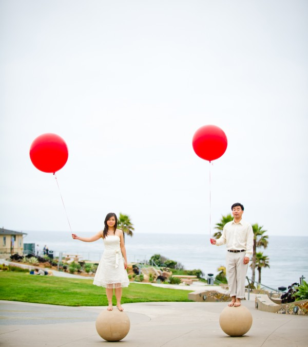 True Photography San Diego Wedding Photographer creative engagement photo shoot with red balloons at the beach
