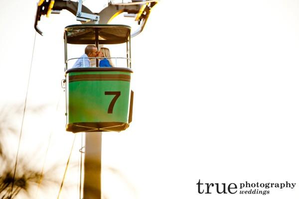 San Diego Wedding Photography- Kissing on the Skyfari sky tram at a San Diego Zoo engagement shoot