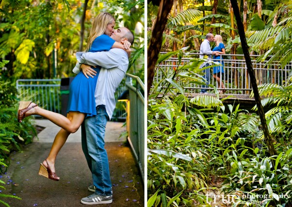 San Diego Zoo engagement photography kissing on a bridge in the jungle
