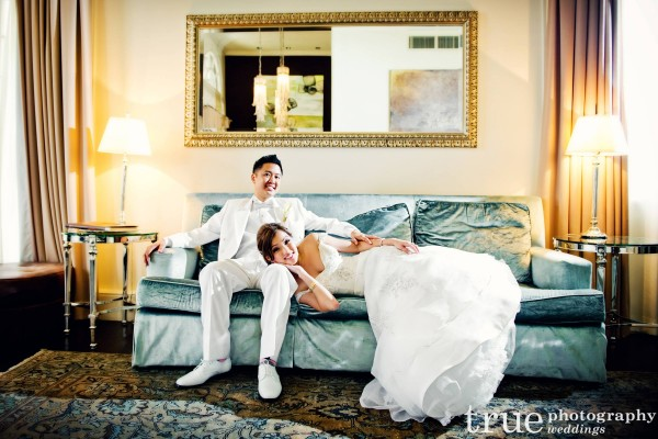 wedding couple laying on a couch at the Us Geant hotel, San Diego