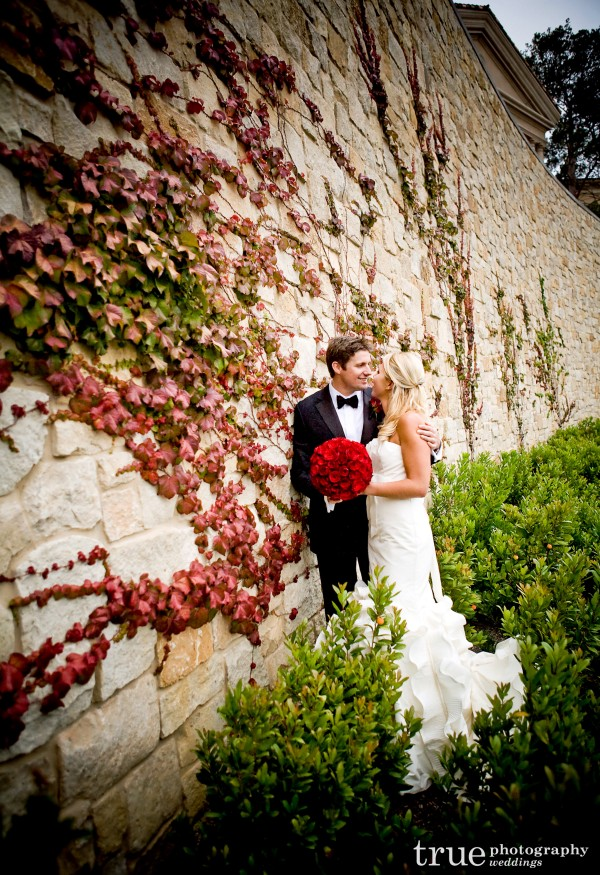 Orange County Wedding Photographers_ Bride and grooom portrait against wall at Pelican Hill, Orange County
