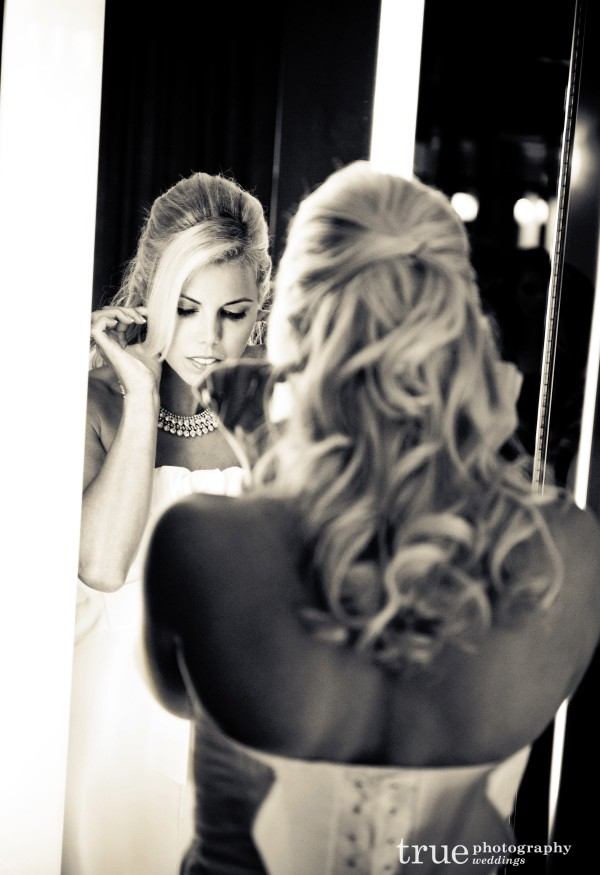 Orange County Wedding Photographer_ Bride getting ready in mirror before Pelican Hill wedding ceremony