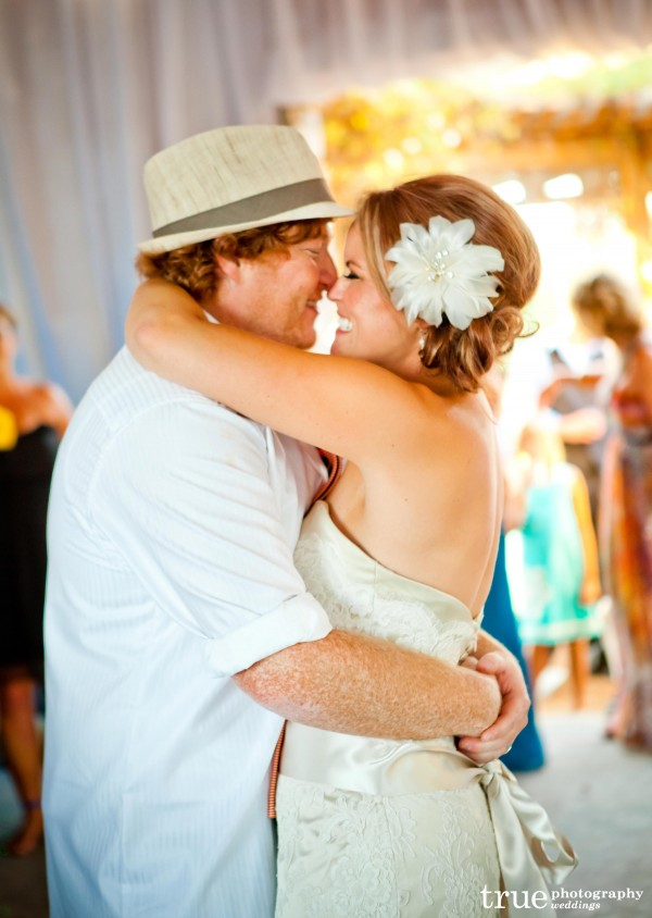 San Diego Wedding Photography: Bride and groom smiling and kissing during first dance at Temecula winery weddings