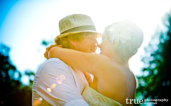San Diego wedding photography: Photo of light shining on bride and groom during first dance at Temecula wedding