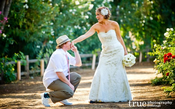 San Diego Wedding Photography: Funny photo of bride and groom after ceremony at Temecula winery wedding