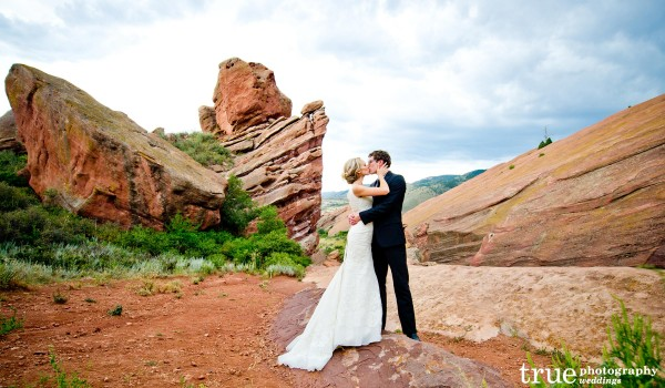 San Diego Wedding Photography: Bride and groom kiss at Red Rocks Park in Colorado during reception