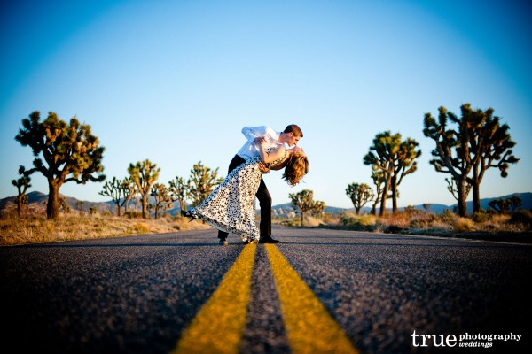 San Diego Wedding Photography: Engagement Shoot dancing in the middle of the street in the desert;  desert wedding pictures