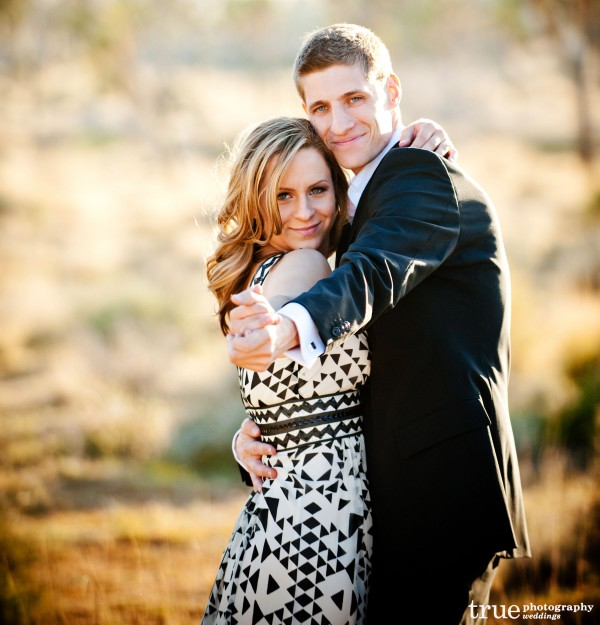 San Diego Wedding Photography: Engagement photography in Joshua Tree dancing in a dress and suit in the desert;  desert wedding pictures