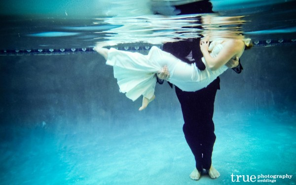 San Diego Wedding Photographer: Engagement shoot underwater with bride and groom in wedding attire for unique Save-the-Dates