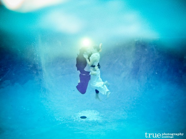 San Diego Wedding Photographers: Engagement shoot underwater bride and groom wearing wedding clothes for unique wedding Save-the-Dates