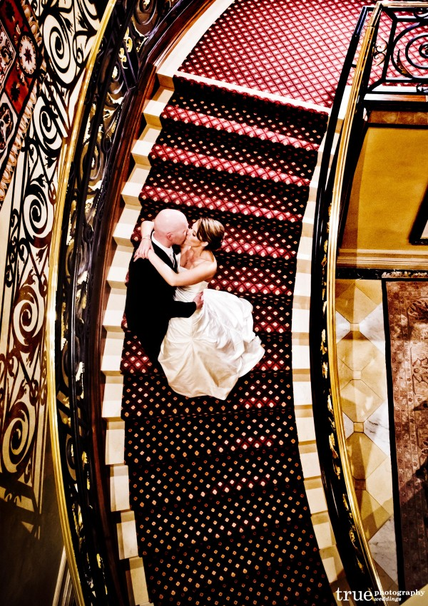 San Diego Wedding Photographers: Photo of bride and groom kissing on staircase at Grand Del Mar wedding
