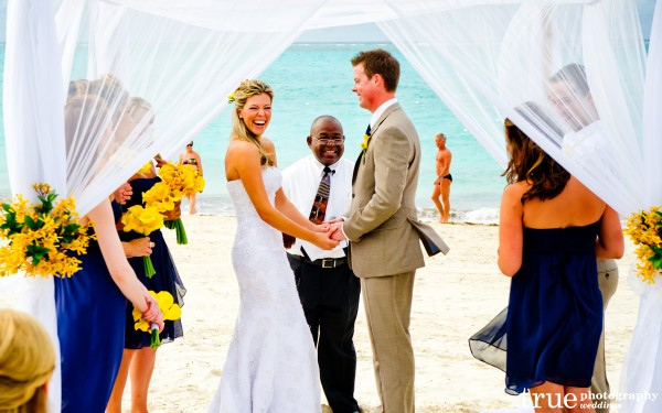 San Diego Wedding Photographer: Destination wedding on the beach in Turks and Caicos bride laughing during ceremony