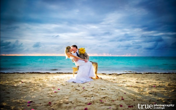 San Diego Wedding Photography: Destination wedding in Turks and Caicos bride and groom kissing on the beach