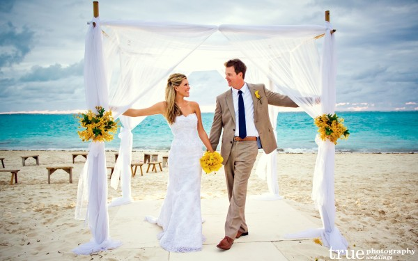San Diego Wedding Photographer: Destination wedding in Turks & Caicos bride and groom posing on the beach