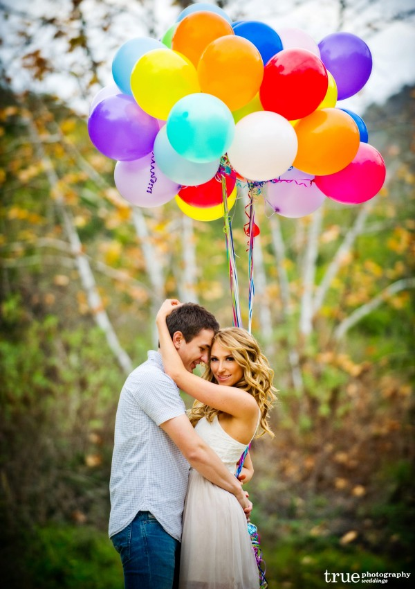 San Diego Wedding Photography: Engagement shoot in a field with bright colored balloons