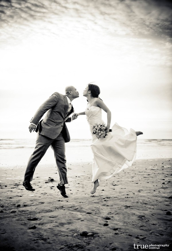 San Diego Wedding Photographer: Bride and groom kissing on the beach in San Diego